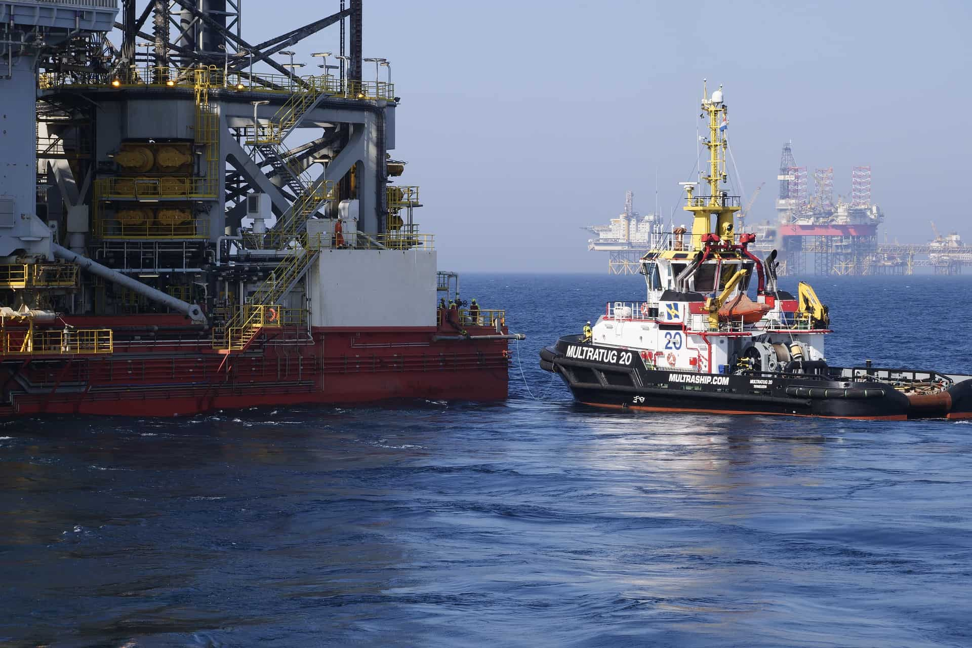 Transportation boat arriving at offshore oil and gas rig