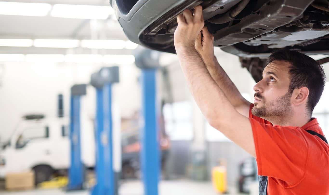 Mechanic working on automobile